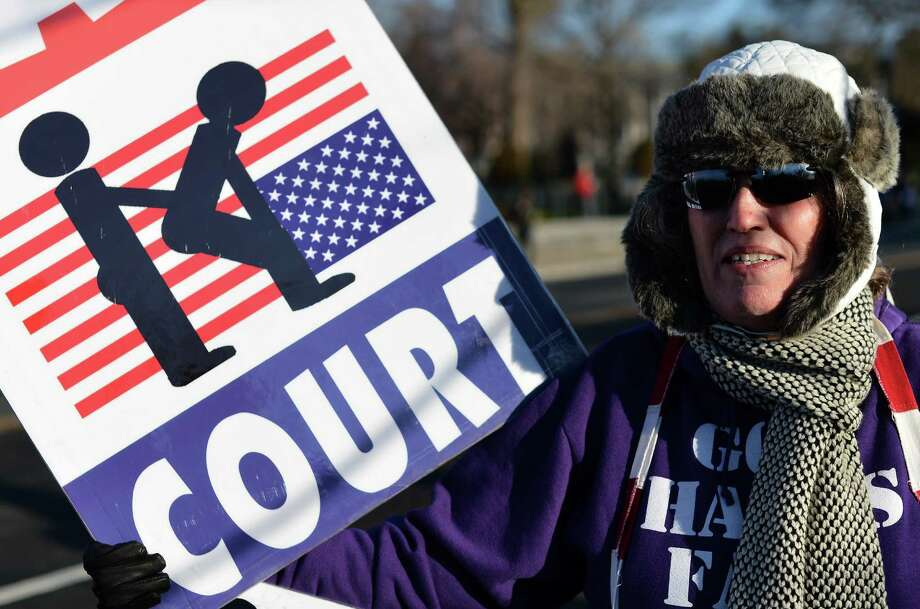 Anti-gay protesters display placards in front of the US Supreme Court. Photo: JEWEL SAMAD, Getty Images / 2013 AFP