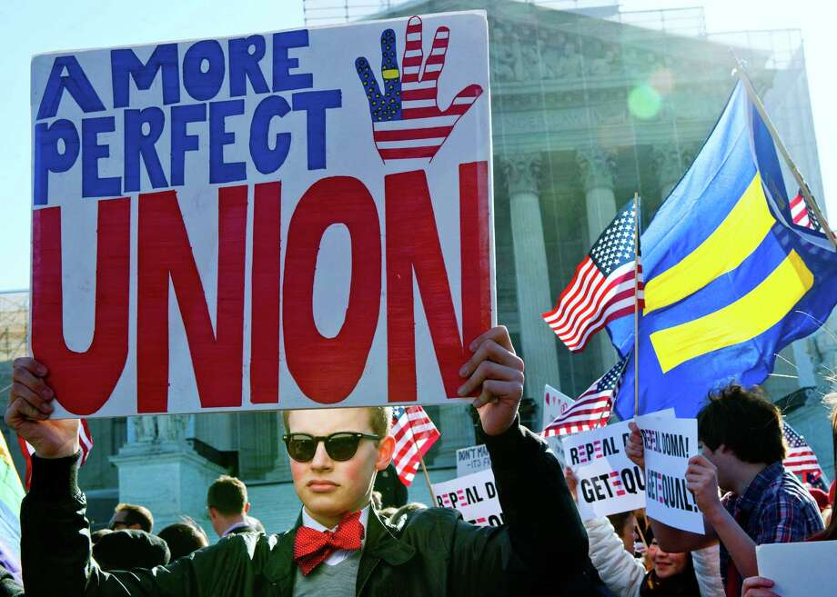 A gay marriage supporter holds a placard at the US Supreme Court on March 27, 2013 in Washington, DC. Photo: KAREN BLEIER, Getty Images / 2013 AFP