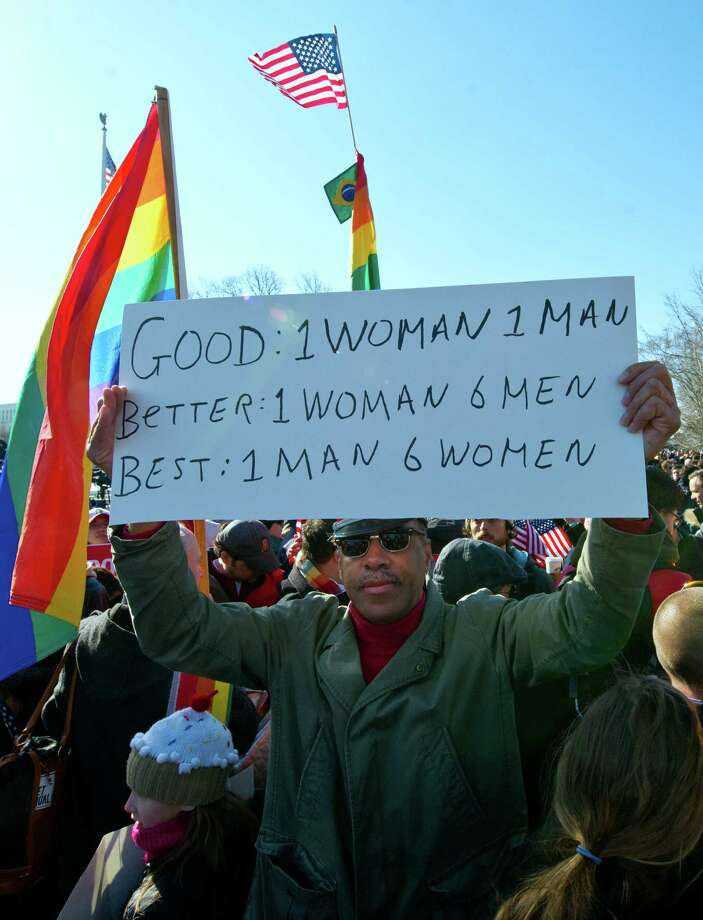 A man marches with a placard in front of Gay marriage supporters at the US Supreme Court on March 27, 2013 in Washington, DC. Photo: KAREN BLEIER, Getty Images / 2013 AFP
