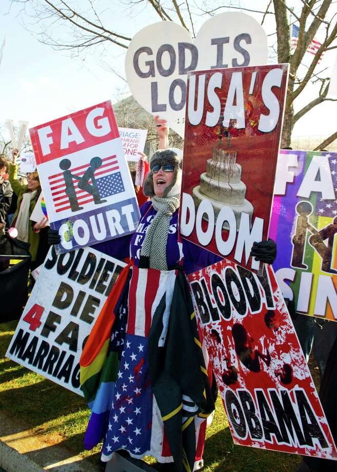 A protester with Godhatesfags.com shouts anti-gay slogans in front of the US Supreme Court March 26, 2013 in Washington, DC. Photo: KAREN BLEIER, Getty Images / 2013 AFP