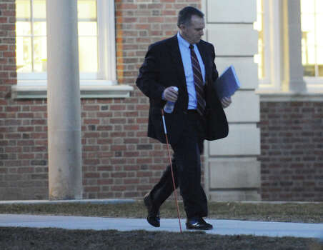 Danbury States Attorney Stephen Sedensky leaves the Newtown Municipal Center after the state police debriefing for families involved in the Sandy Hook shooting in Newtown, Conn. on Wednesday, March 27, 2013. Photo: Tyler Sizemore / The News-Times