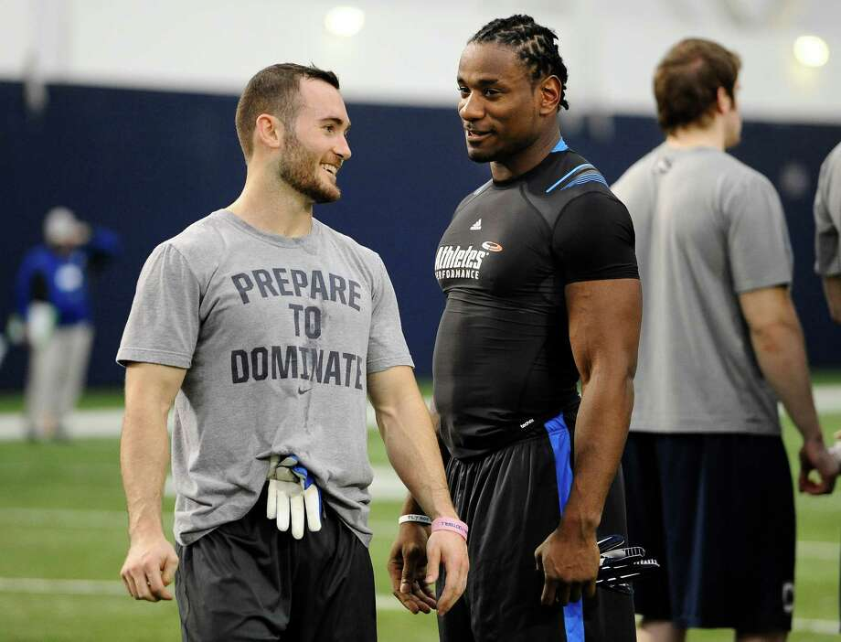 UConn's Wide receiver and kick returner Nick Williams and linebacker Sio Moore, right, speak to one another at UConn's NFL football pro day in Storrs, Conn., Wednesday, March 27, 2013. (AP Photo/Jessica Hill) Photo: Jessica Hill, Associated Press / FR125654 AP