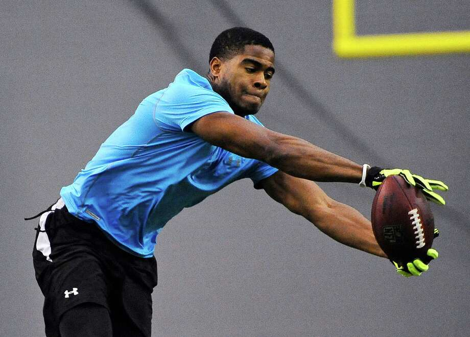 Connecticut cornerback Blidi Wreh Wilson catches a ball during a workout at NFL football pro day in Storrs, Conn., Wednesday, March 27, 2013. (AP Photo/Jessica Hill) Photo: Jessica Hill, Associated Press / FR125654 AP