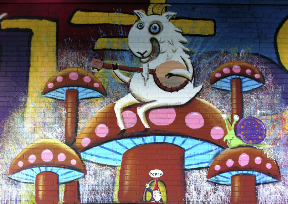 3. Banjo-playing goat? Check. Pipe-smoking gnome? Check. Yup, that's a Henry, as in muralist Ryan Henry Ward, whose street paintings of cheery, quirky animals brighten up the city. This one jazzes up a blighted stretch of Rainier Avenue South. (seattlepi.com photo).