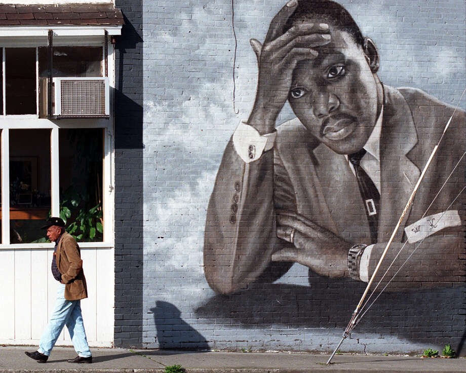 5. You don't need blazing color to have impact. This contemplative 1995 portrait, by James Crespinel, honors Martin Luther King Jr. on the wall of Catfish Corner in the Central District.  Photo: KURT SMITH/PI