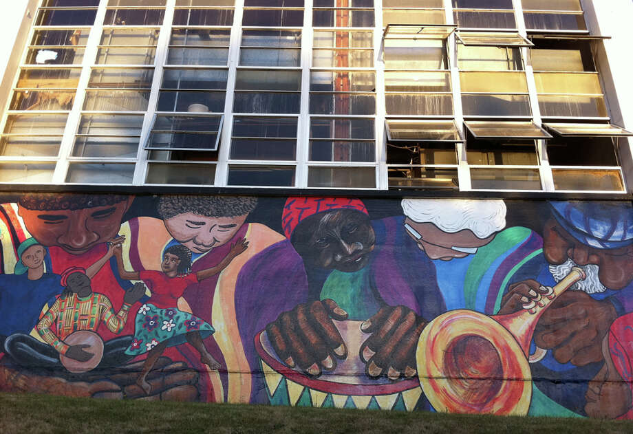 9. This tableau is part of a vibrant four-paneled set inspired by diversity, labor, music and dance. It lines Seattle Central Community College's woodworking school on 23rd Avenue South. (seattlepi.com photo).