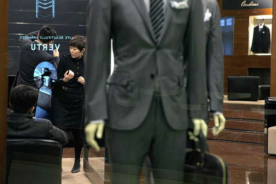 Chinese President Xi Jinping has clamped down on displays of wealth by government and military officials, affecting luxury retailers like this one in Beijing. Photo: SIM CHI YIN, STR / NYTNS