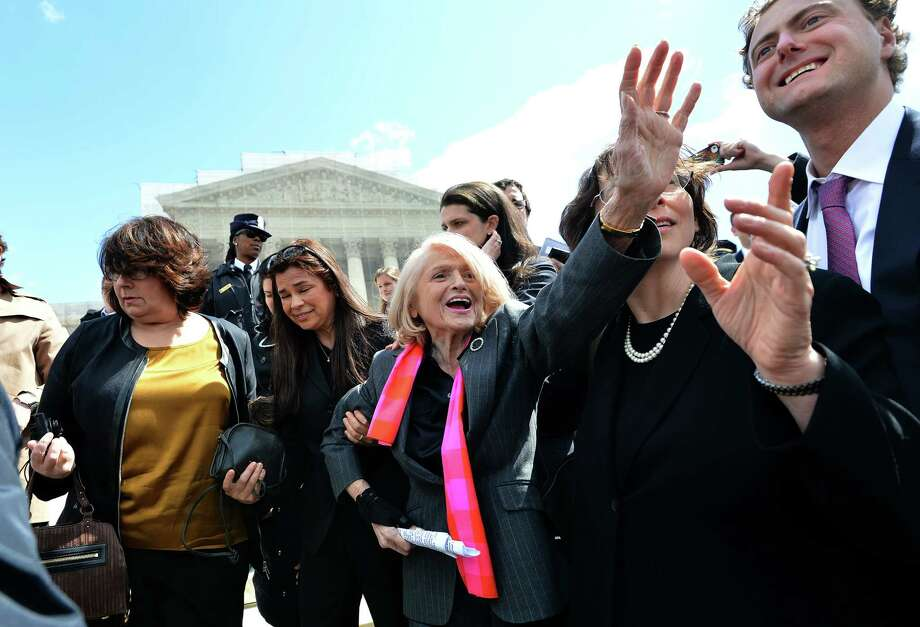 The plaintiff in the case challenging the constitutionality of Section 3 of the Defense of Marriage Act, 83-year-old widow Edie Windsor, center, greets same-sex marriage supporters outside the Supreme Court on Wednesday in Washington. Photo: JEWEL SAMAD, Staff / AFP