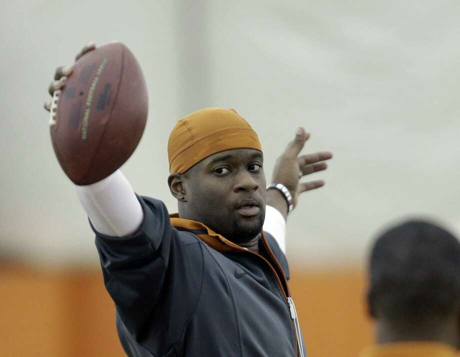 Former UT QB Vince Young at least has his college coach convinced he can still play in the pros. Photo: Eric Gay / Associated Press