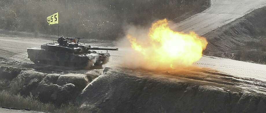 A South Korean army tank fires live rounds during an exercise at Seungjin Fire Training Field in mountainous Pocheon, near the border with North Korea. Photo: Lim Byung-shick / Yonhap / Associated Press