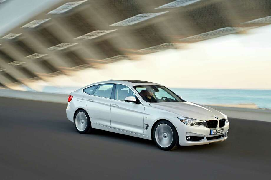 This photo provided by BMW shows the new BMW 3 Series Gran Turismo, one of two important variations of its popular 3-Series small luxury sports sedans. Photo: Daniel Kraus, Associated Press / BMW