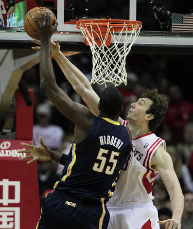 Rockets center Omer Asik, right, blocks Roy Hibbert. Photo: James Nielsen, Houston Chronicle / © 2013 Houston Chronicle
