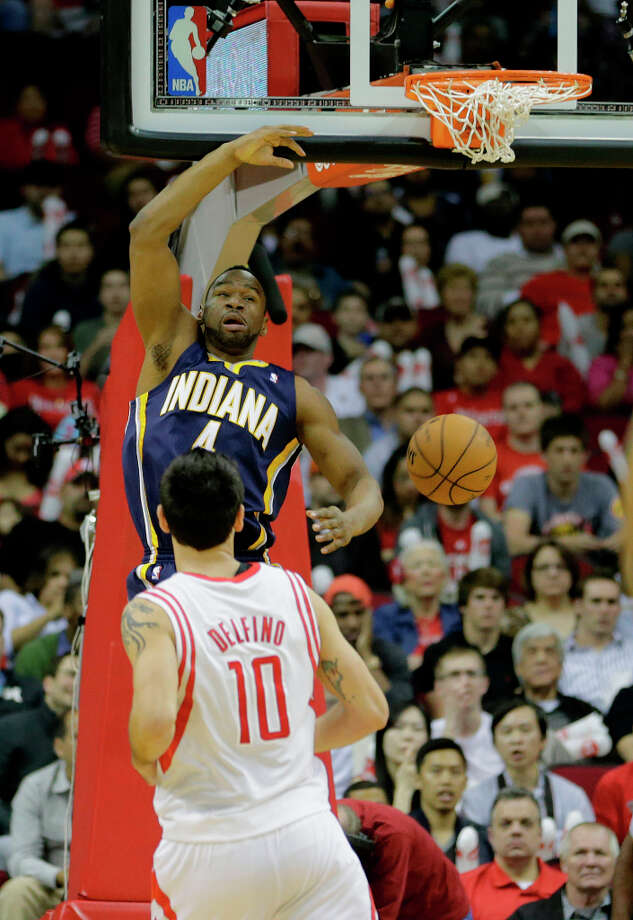 Pacers small forward Sam Young slams home a fast break. Photo: James Nielsen, Houston Chronicle / © 2013 Houston Chronicle