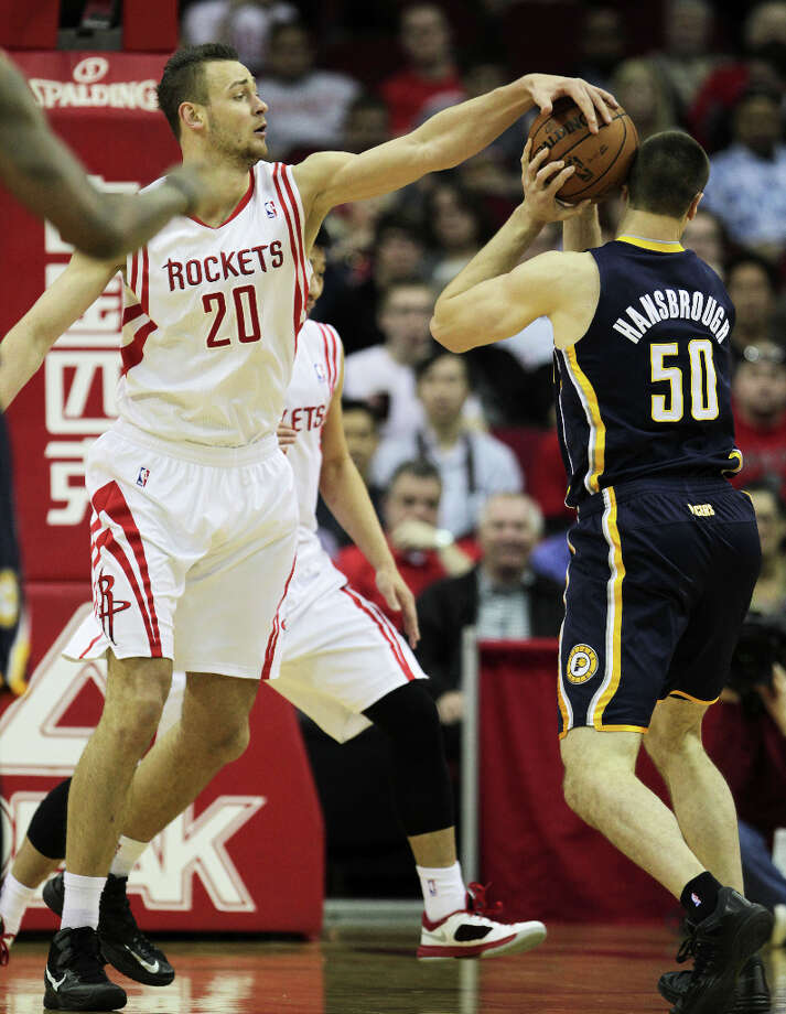 Rockets power forward Donatas Motiejunas, left, guards Pacers power forward Tyler Hansbrough. Photo: James Nielsen, Houston Chronicle / © 2013 Houston Chronicle