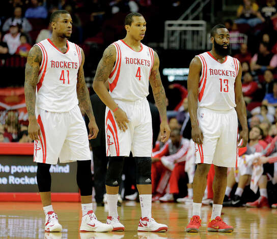 Thomas Robinson, left, Greg Smith, center, and James Harden, right, wait for play to resume. Photo: James Nielsen, Houston Chronicle / © 2013 Houston Chronicle