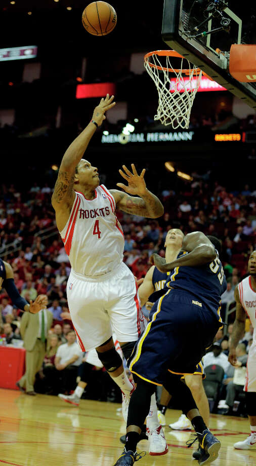 Rockets power forward Greg Smith, left, watches his shot as Pacers center Roy Hibbert, right, looks on. Photo: James Nielsen, Houston Chronicle / © 2013 Houston Chronicle