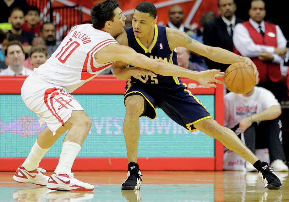 Rockets shooting guard Carlos Delfino, left, plays defense against Pacers small forward Gerald Green, right, during the second quarter. Photo: James Nielsen, Houston Chronicle / © 2013 Houston Chronicle