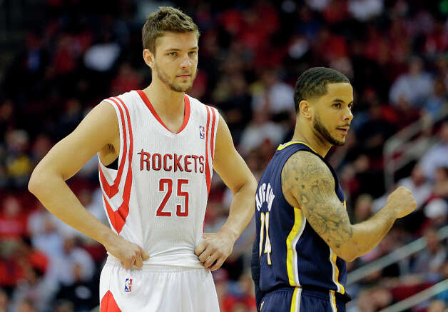 Rockets small forward Chandler Parsons, left, and Pacers point guard D.J. Augustin, right, wait for play to resume. Photo: James Nielsen, Houston Chronicle / © 2013 Houston Chronicle