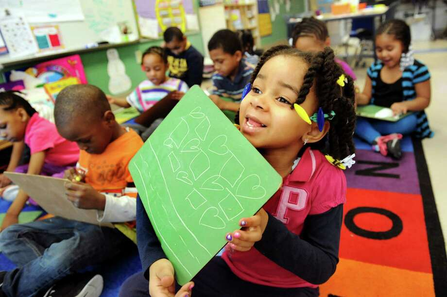 Kindergartner Jade Boyke, 5, right, shows her chalkboard during a patterning exercise on Wednesday, March 27, 2013, at Arbor Hill Elementary in Albany, N.Y. (Cindy Schultz / Times Union) Photo: Cindy Schultz / 00021765A