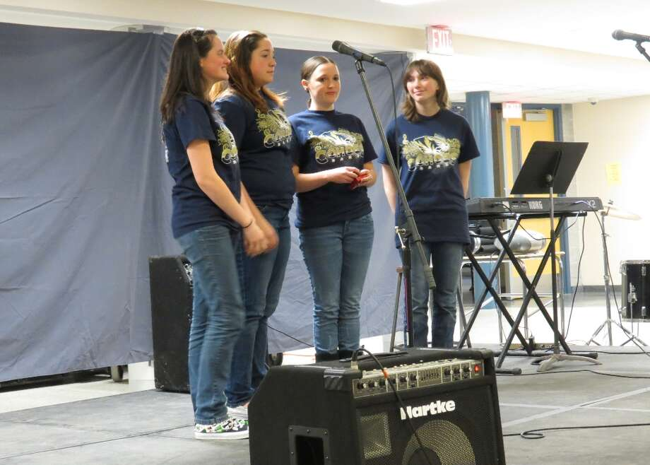 Tessa Goodine, junior, Emily Taylor, sophomore, Emily Daigneault, senior, and Kristen Gillespie, junior, sing Let Tonight Be the Night. Photo by Jenna Colozza Photo: Picasa