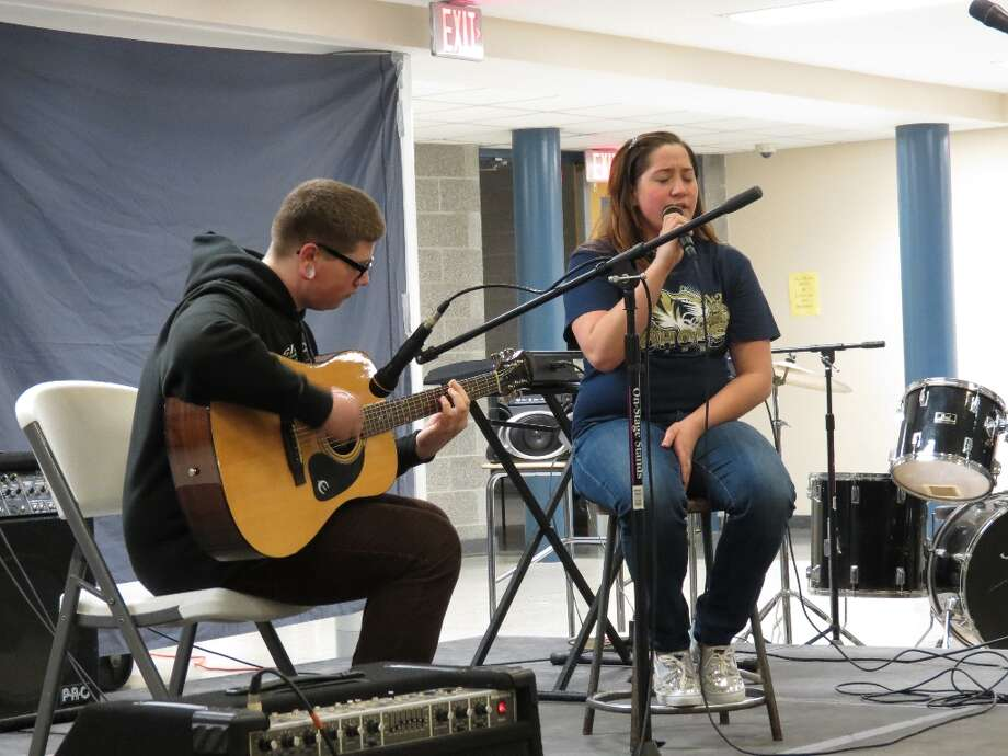 James Zehner, sophomore, plays guitar while Emily Taylor sings Iris by the Goo Goo Dolls. Photo by Jenna Colozza
