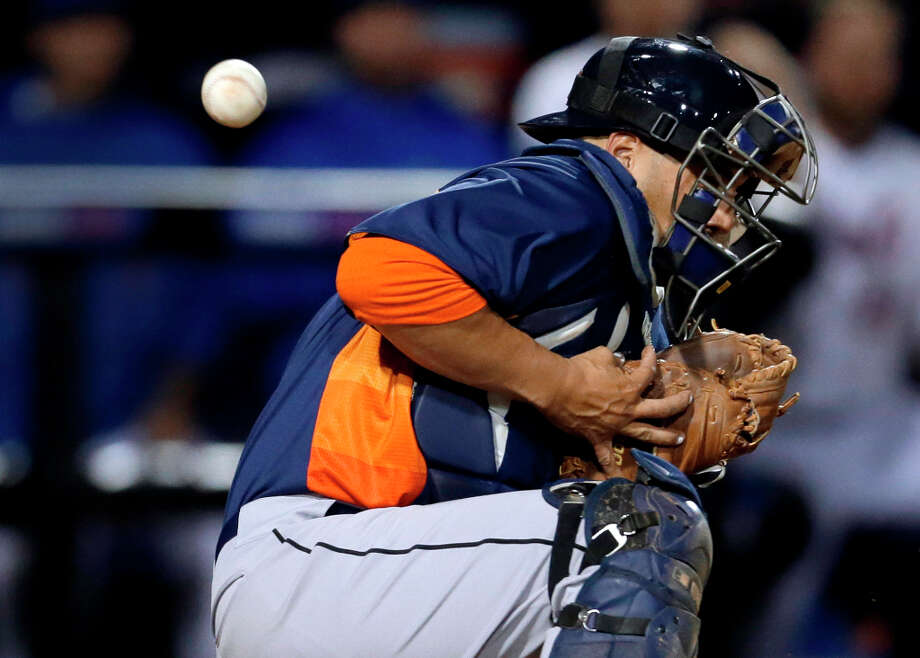 A throw home from Astros shortstop Carlos Correa gets past catcher Jason Jaramillo, allowing John Buck to score during the sixth inning. Photo: Jeff Roberson, Associated Press / AP