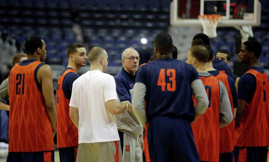 Syracuse head coach Jim Boeheim, center, talks with his players at the end of practice for a regional semifinal game in the NCAA college basketball tournament, Wednesday, March 27, 2013, in Washington. Syracuse plays Indiana on Thursday. (AP Photo/Pablo Martinez Monsivais) Photo: Pablo Martinez Monsivais