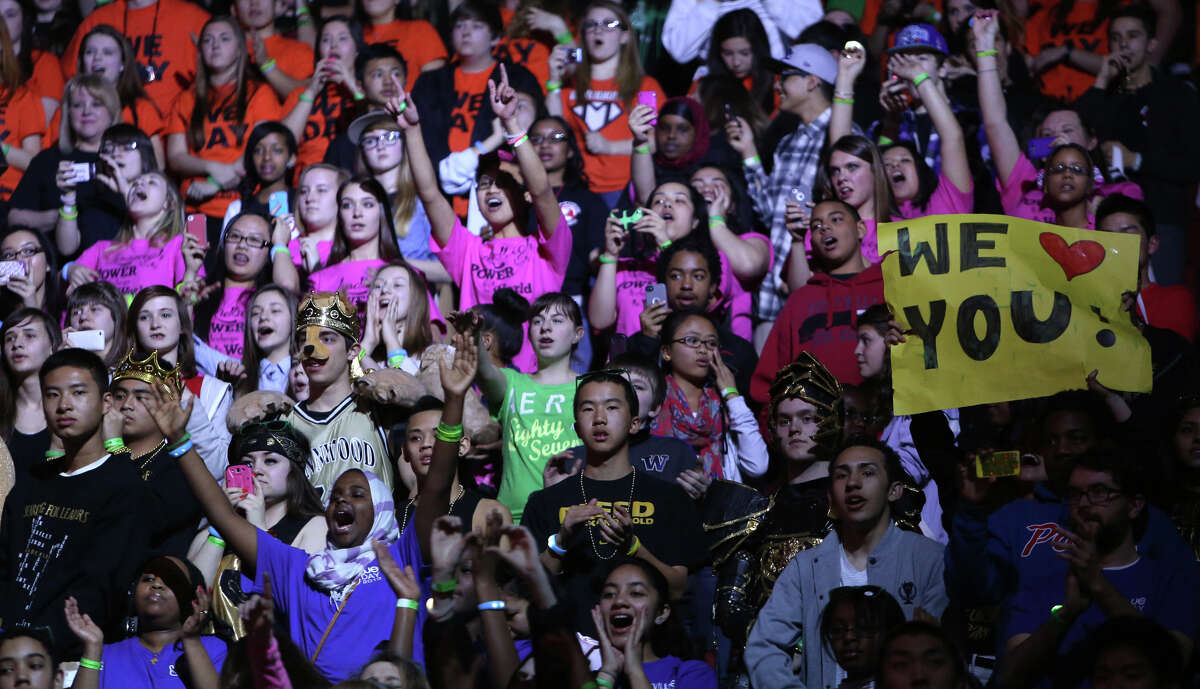 Students cheer during We Day at KeyArena in Seattle. The event brought thousands of middle and high school students together to hear from a list of celebrities and motivational speakers. We Day is a youth educational and empowerment event organized by the Free the Children charity. Students earned a seat at the event through their commitment to do good.