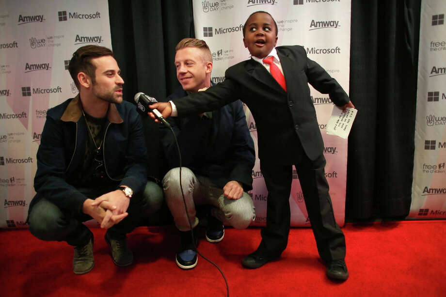 Ryan Lewis and Ben Haggerty, aka Macklemore, are interviewed by Kid President, aka Robbie Novak during We Day at KeyArena in Seattle. Photo: JOSHUA TRUJILLO / SEATTLEPI.COM