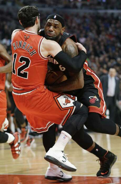 LeBron James had another double-double with 32 points and 11 rebounds, but the Heat couldn't get past Kirk Hinrich and the short-handed Bulls. Photo: Nam Y. Huh / Associated Press