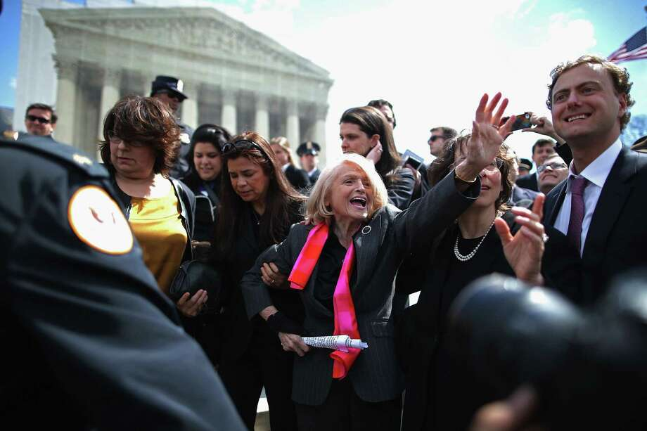 Edith Windsor (center) is mobbed as she leaves the Supreme Court. Hers is the second same-sex-marriage case this week. Photo: Chip Somodevilla / Getty Images