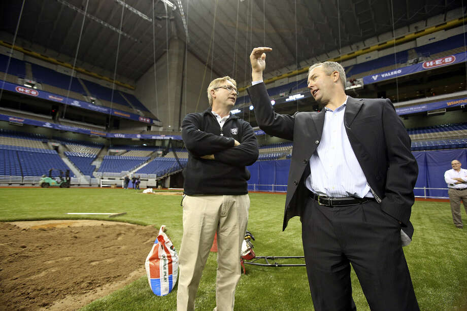 Reid Ryan (right), an executive with Ryan Sanders Baseball, surveys the Alamodome grounds Wednesday. The company is footing the bill for the two-game exhibition series. Photo: Tom Reel / San Antonio Express-News
