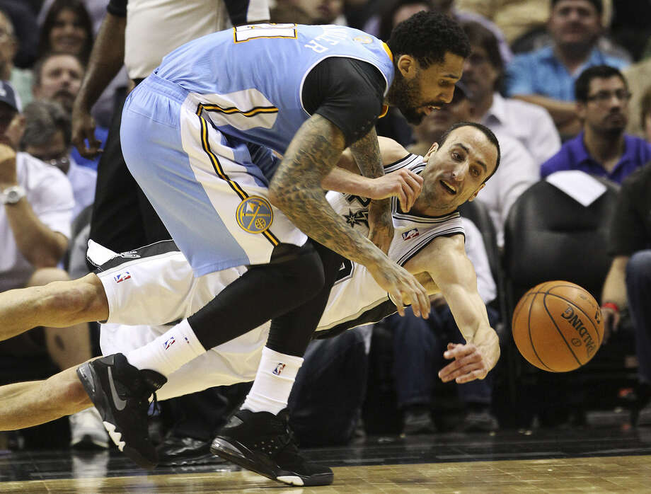 The Spurs' Manu Ginobili (right), who had nine points, dives to try and beat Denver's Wilson Chandler to the ball. Photo: Kin Man Hui / San Antonio Express-News