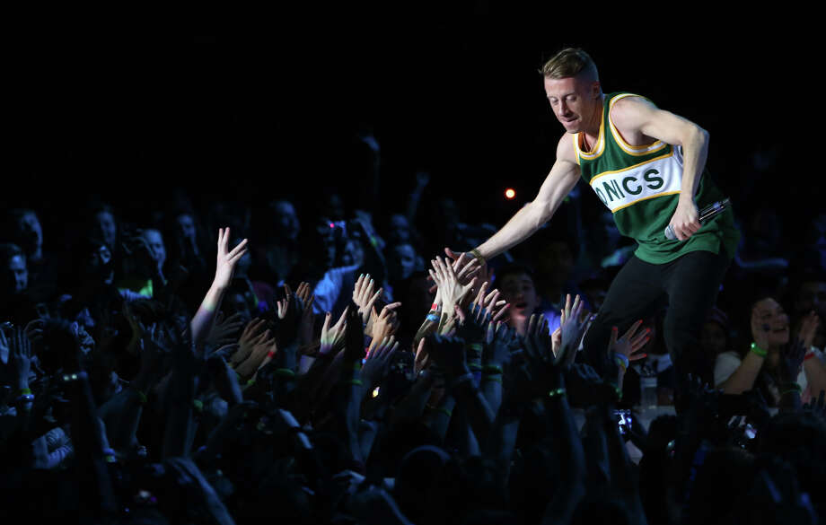 Surprise musical guest Macklemore and Ryan Lewis greet screaming fans during We Day. Photo: JOSHUA TRUJILLO / SEATTLEPI.COM