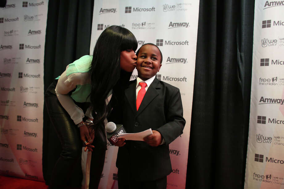 Performer Jennifer Hudson plants a kiss on Kid President, aka Robbie Novak, during We Day. Photo: JOSHUA TRUJILLO / SEATTLEPI.COM