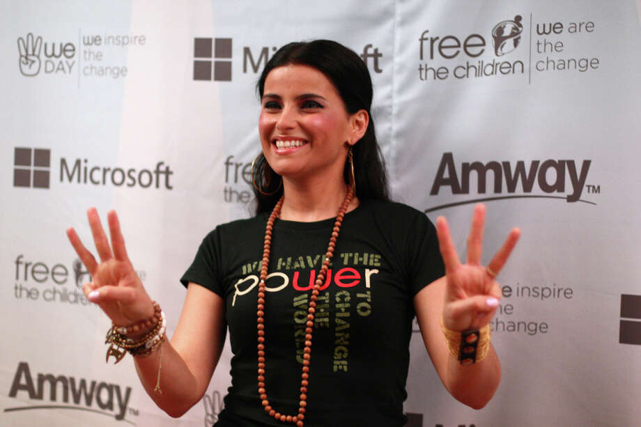 Nelly Furtado walks a red carpet during We Day. Photo: JOSHUA TRUJILLO / SEATTLEPI.COM