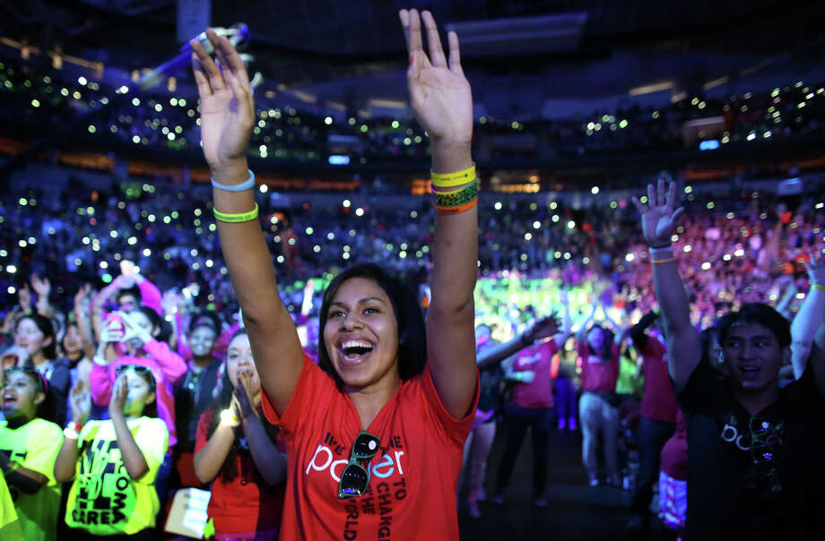 Chelsa Leae of Decatur High School throws up her arms during We Day. Photo: JOSHUA TRUJILLO / SEATTLEPI.COM