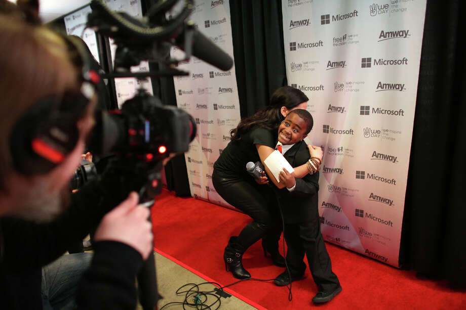 Nelly Furtado embraces Kid President, aka Robbie Novak, during a We Day red carpet event. Photo: JOSHUA TRUJILLO / SEATTLEPI.COM