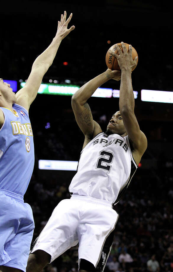 Spurs' Kawhi Leonard (02) fades for a shot against Denver Nuggets' Danilo Gallinari (08) in the first quarter at the AT&T Center on Wednesday, Mar. 27, 2013. Photo: Kin Man Hui, San Antonio Express-News / © 2012 San Antonio Express-News