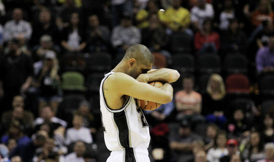 Spurs' Tim Duncan (21) performs his pre-tip off ritual before the game against the Denver Nuggets at the AT&T Center on Wednesday, Mar. 27, 2013. Photo: Kin Man Hui, San Antonio Express-News / © 2012 San Antonio Express-News