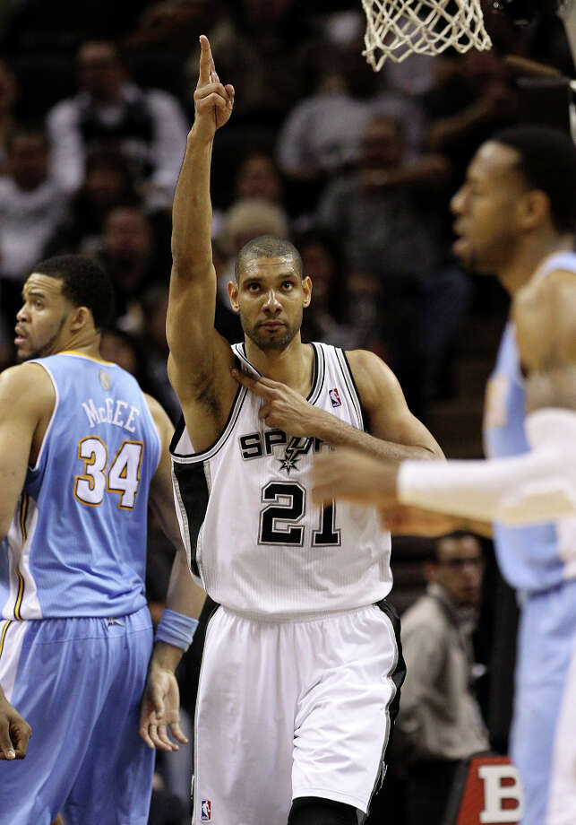 Spurs' Tim Duncan (21) gestures after a play goes in favor of the Spurs during the game against the Denver Nuggets in the second half at the AT&T Center on Wednesday, Mar. 27, 2013. Spurs defeated the Nuggets, 100-99. Photo: Kin Man Hui, San Antonio Express-News / © 2012 San Antonio Express-News