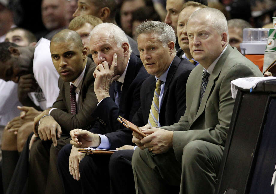 The Spurs' coaches watch a close game against the Denver Nuggets in the second half at the AT&T Center on Wednesday, Mar. 27, 2013. Spurs defeated the Nuggets, 100-99. Photo: Kin Man Hui, San Antonio Express-News / © 2012 San Antonio Express-News