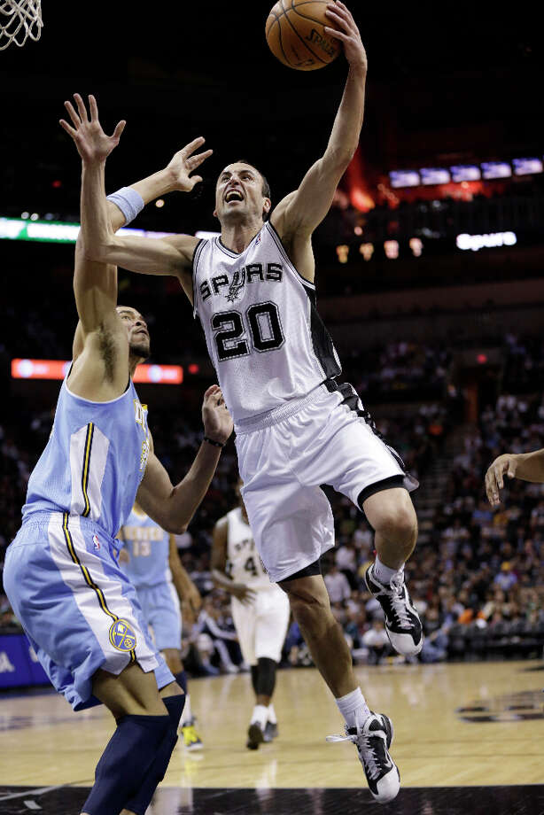 San Antonio Spurs' Manu Ginobili (20), of Argentina, drives to the basket past Denver Nuggets' JaVale McGee, left, during the first half of an NBA basketball game, Wednesday, March 27, 2013, in San Antonio. Photo: Eric Gay, Associated Press / AP