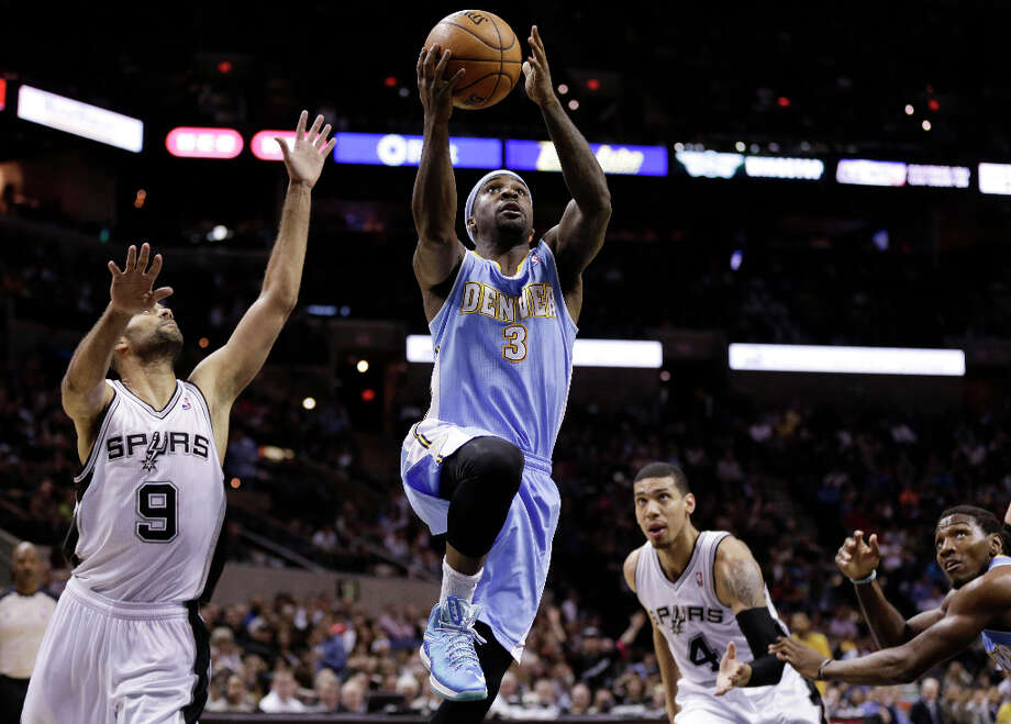 Denver Nuggets' Ty Lawson (3) drives past San Antonio Spurs' Tony Parker (9), of France, and Danny Green (4) to score during the second half of an NBA basketball game, Wednesday, March 27, 2013, in San Antonio. San Antonio won 100-99. Photo: Eric Gay, Associated Press / AP