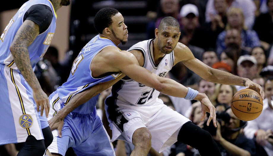 San Antonio Spurs' Tim Duncan (21) is pressured by Denver Nuggets' JaVale McGee, center, during the second half of an NBA basketball game, Wednesday, March 27, 2013, in San Antonio. San Antonio won 100-99. Photo: Eric Gay, Associated Press / AP