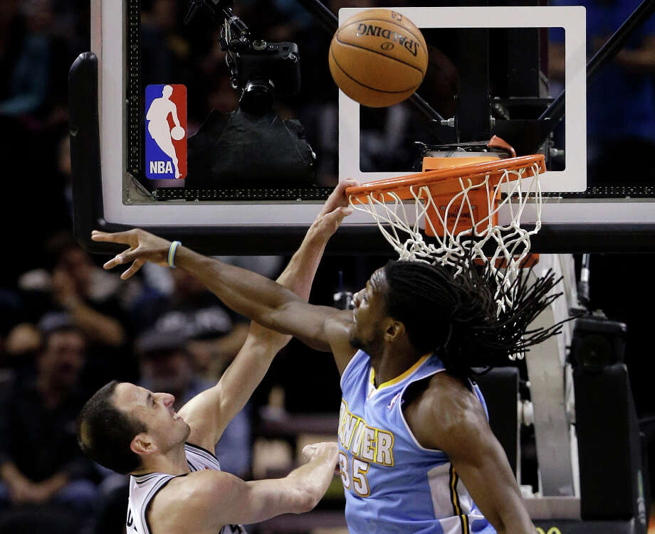 San Antonio Spurs' Manu Ginobili, left, of Argentina, goes to the basket as Denver Nuggets' Kenneth Faried (35) defends during the second half of an NBA basketball game, Wednesday, March 27, 2013, in San Antonio. San Antonio won 100-99. Photo: Eric Gay, Associated Press / AP