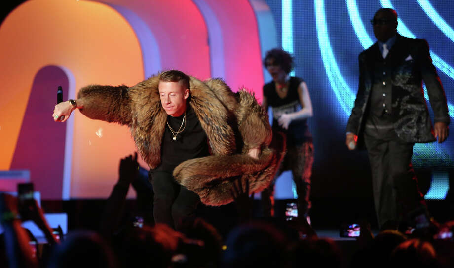 "Macklemore and Ryan Lewis perform their song ""Thrift Shop"" during We Day. Photo: JOSHUA TRUJILLO / SEATTLEPI.COM"