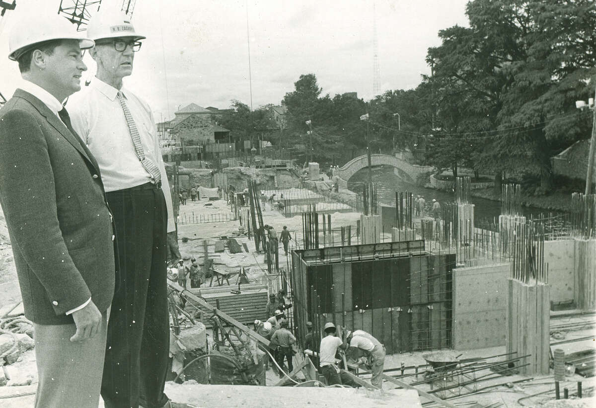 H.B. Zachry and Barron Hilton oversee construction at the Hilton Palacio del Rio Hotel in August 1967. The hotel was entirely constructed without a permit, and Zachry filed for one after it was finished.