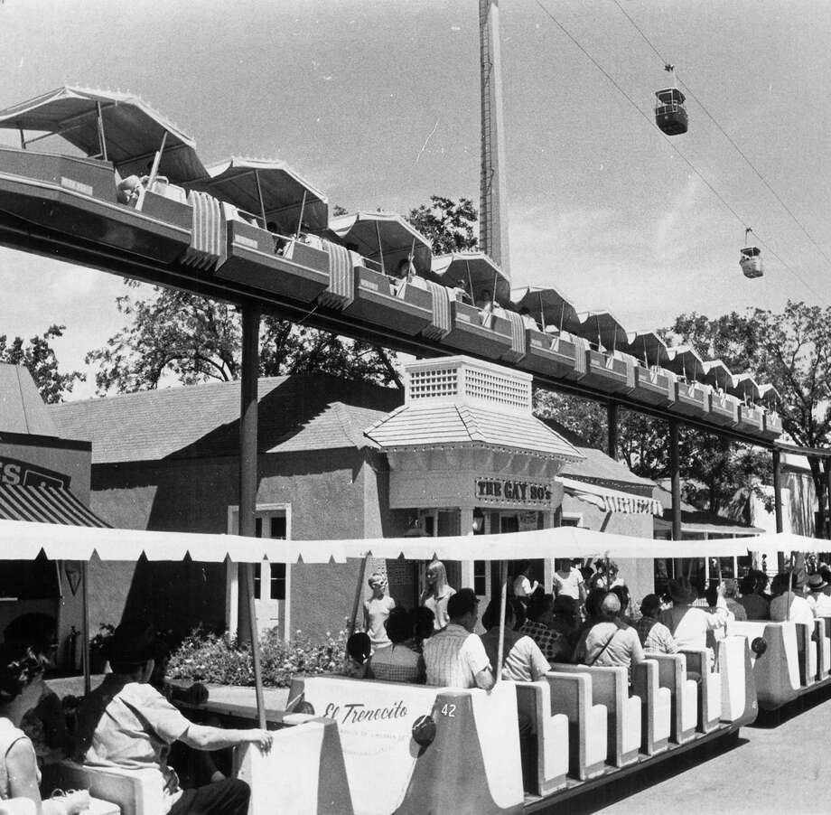 Visitors to HemisFair '68 ride the mini-monorail (top) and El Trenecito (the little train, bottom) on July 19, 1968. A round-trip on the monorail cost $1, whereas a trip on the train cost 50 cents for adults and 25 cents for children. Photo: San Antonio Express-News File Photo / SAN ANTONIO EXPRESS-NEWS