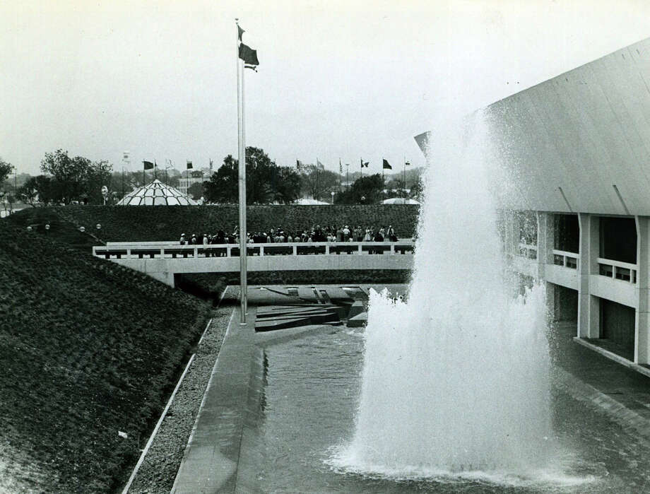 Visitors to the Texas State Pavilion watch the water fountains during HemisFair '68. The pavilion is now the Institute of Texan Cultures. Photo: San Antonio Express-News File Photo / San Antonio Express-News